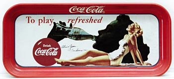 A Coca-Cola tray from the 1940s with Alice Jean Gibb's likeness decorating it. Even though she was never recognized on the street 60 years ago when her face was on billboards and posters everywhere, Gibbs now gets requests from others to autograph memorablilia with her likeness on it that have been purchased at antique shops and flea markets.